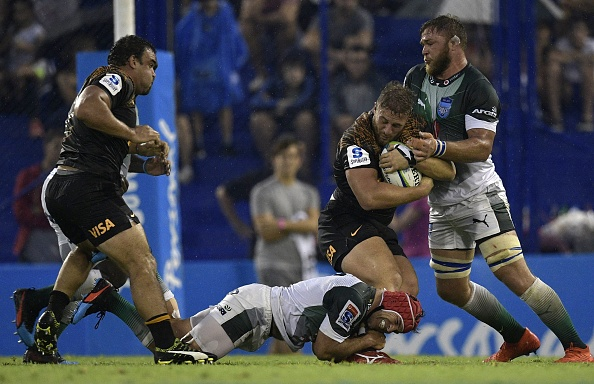 Argentina's Jaguares prop Mayco Vivas (2R) is tackled by South Africa's Bulls hooker Schalk Brits (C) and flanker Hanro Liebenberg during their Super Rugby match at Jose Amalfitani stadium in Buenos Aires, Argentina on February 23, 2019. (Photo by JUAN MABROMATA / AFP)        (Photo credit should read JUAN MABROMATA/AFP/Getty Images)
